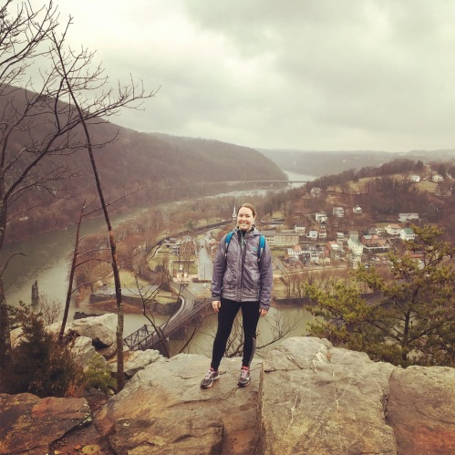 women standing over cliff looking at Harpers Ferry