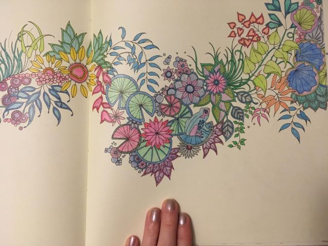 hand on a coloring book